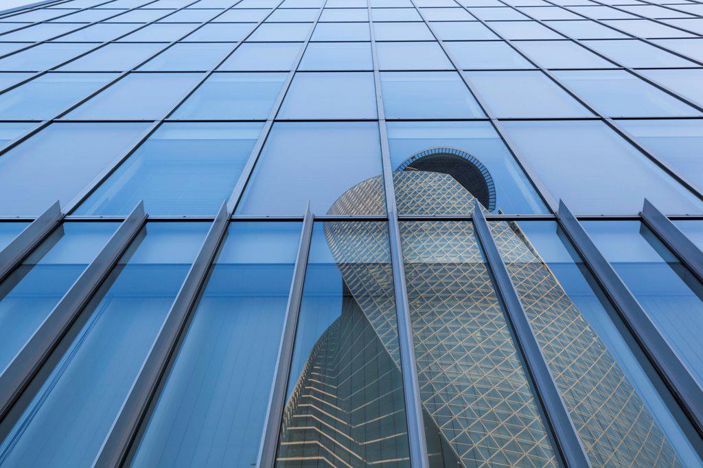 Stock Photo: 442-38850 Japan, Honshu, Aichi, Nagoya, Mode Gakuen Spiral Tower reflecting in glass building
