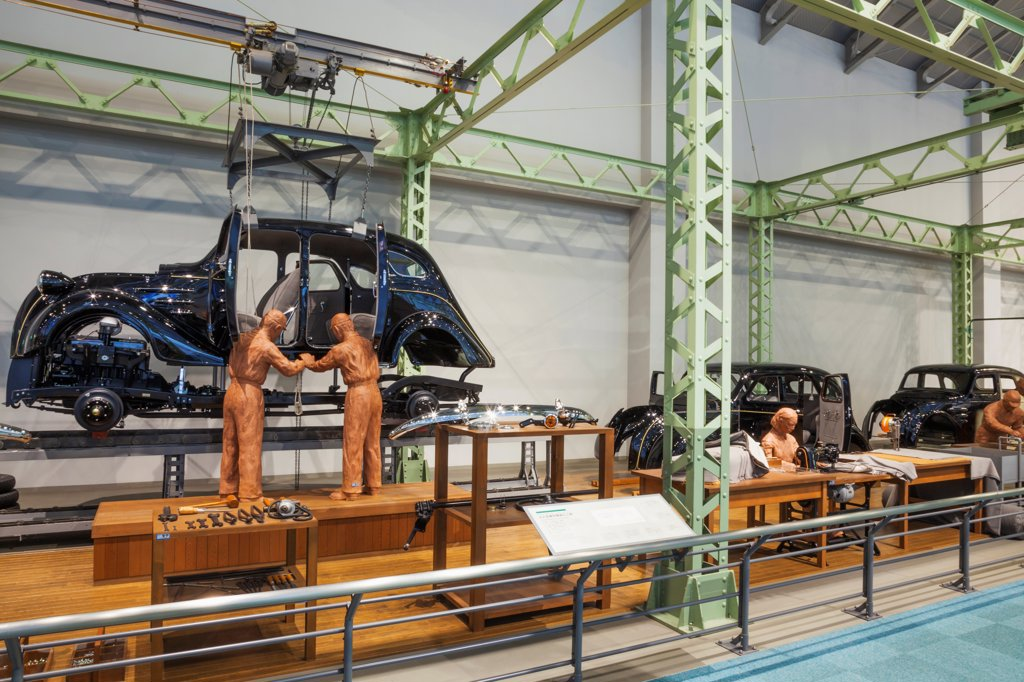 Japan, Honshu, Aichi, Nagoya, Toyota Commemorative Museum of Industry and Technology, Automobile Pavilion, Exhibit depicting The Production Line of Toyota Model A1 Car : Stock Photo