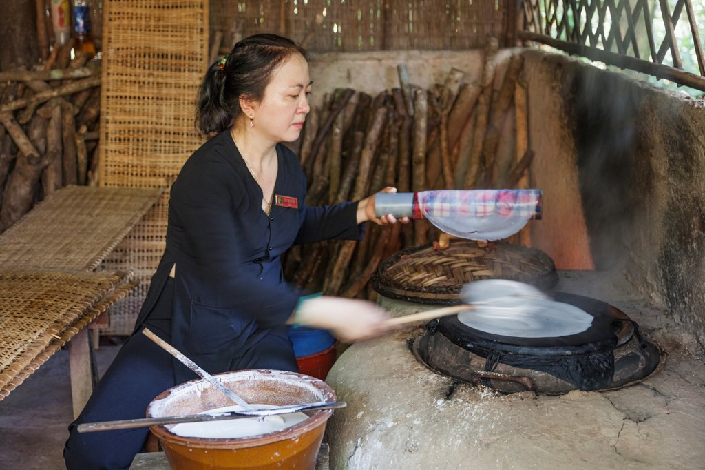Vietnam, Ho Chi Minh City, Cu Chi Tunnels, Demonstration of Rice Paper Making : Stock Photo