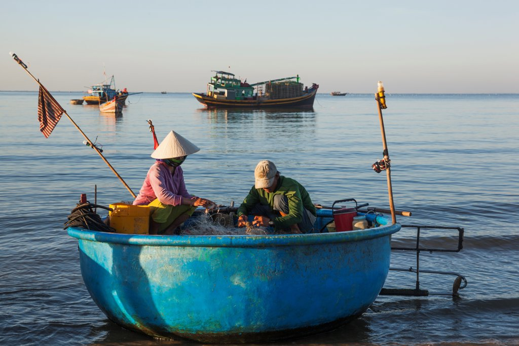 Vietnam, Mui Ne, Mui Ne Beach, Fishermen with Coracle Fishing Boats : Stock Photo
