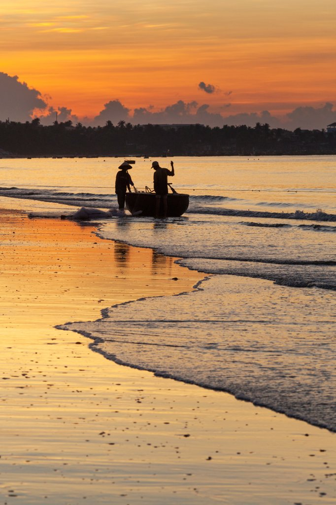 Stock Photo: 442-39032 Vietnam, Mui Ne, Mui Ne Beach, Net Fishermen at Dawn