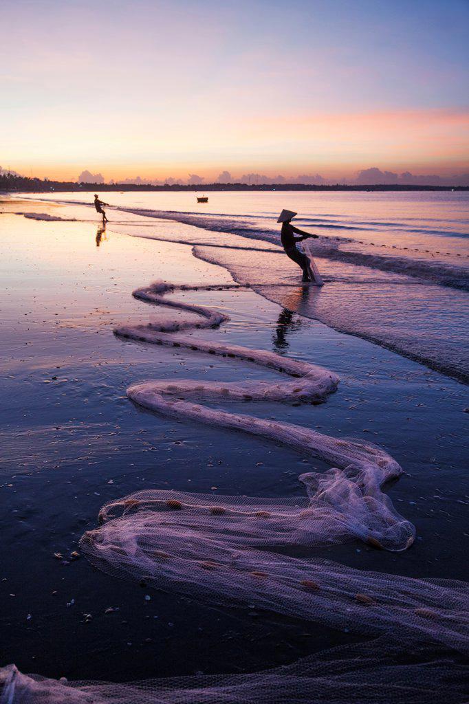 Stock Photo: 442-39033 Vietnam, Mui Ne, Mui Ne Beach, Net Fishermen at Dawn