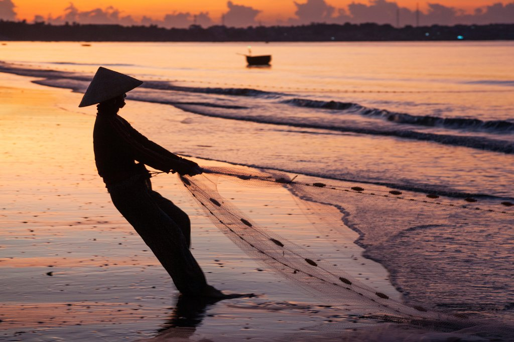Stock Photo: 442-39034 Vietnam, Mui Ne, Mui Ne Beach, Net Fisherwoman at Dawn