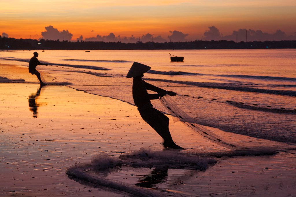 Vietnam, Mui Ne, Mui Ne Beach, Net Fisherwoman at Dawn : Stock Photo