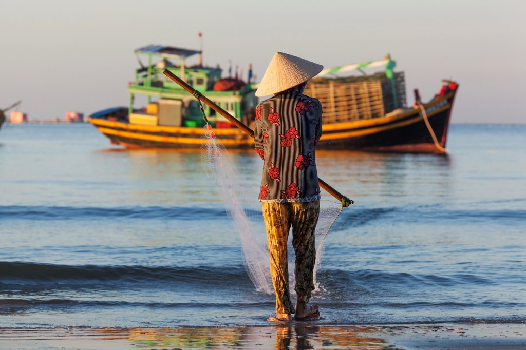 Stock Photo: 442-39042 Vietnam, Mui Ne, Mui Ne Beach, Net Fisherwoman