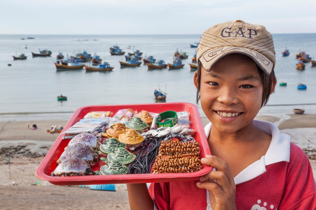 Vietnam, Mui Ne, Mui Ne Beach, Young Child Selling Souvenir Seashells : Stock Photo