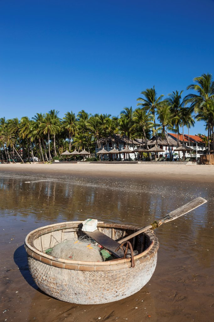 Stock Photo: 442-39062 Vietnam, Mui Ne, Mui Ne Beach, Coracle Fishing Boat and Palm Trees