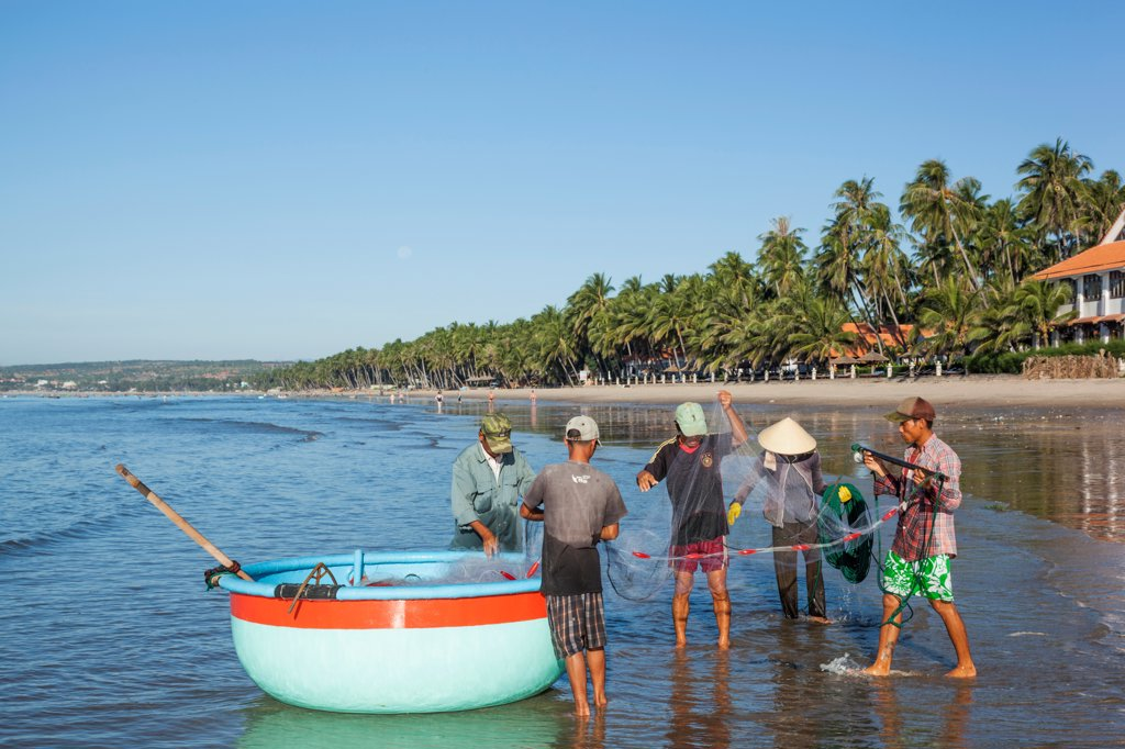 Stock Photo: 442-39066 Vietnam, Mui Ne, Mui Ne Beach, Fishermen and Coracle Fishing Boat
