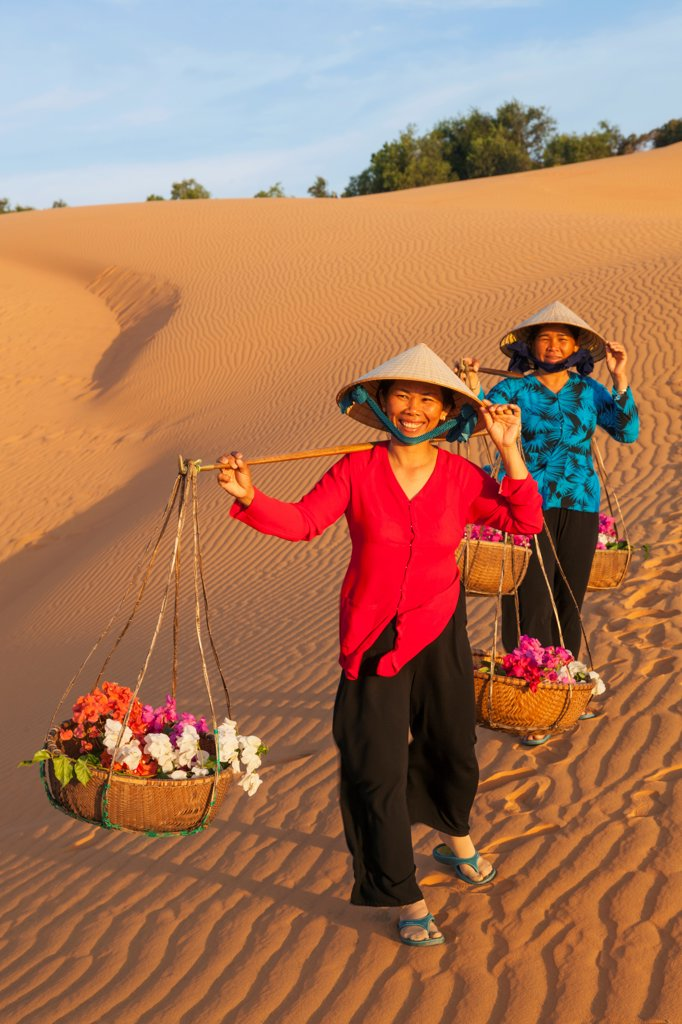 Vietnam, Mui Ne, Sand Dunes and Local Women in Conical Hats : Stock Photo