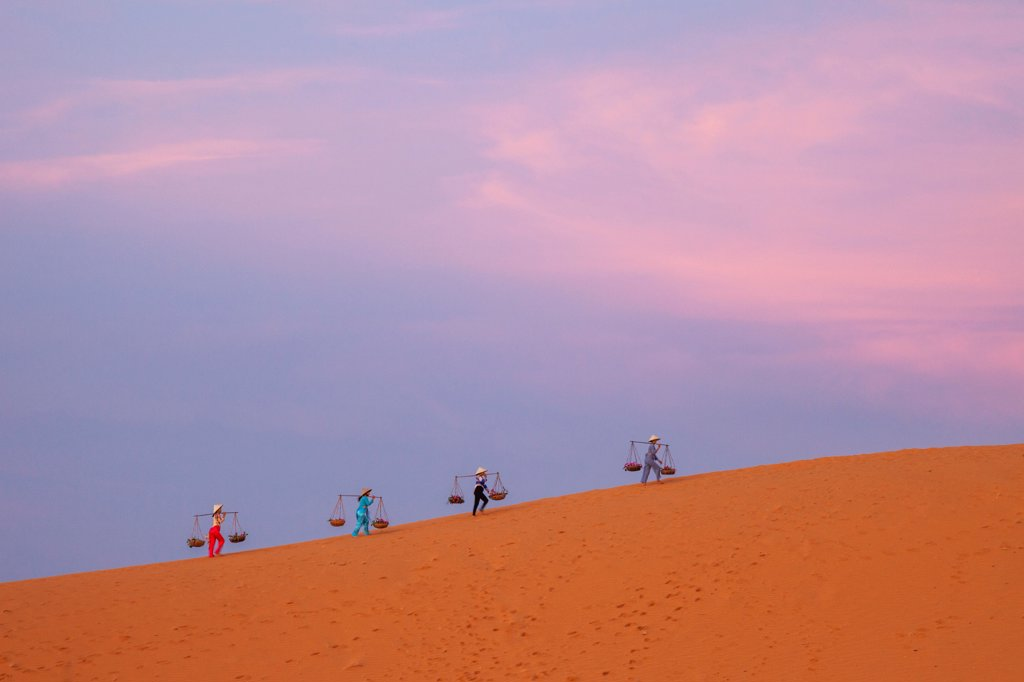 Vietnam, Mui Ne, Sand Dunes, Local Women in Conical Hats at Dawn : Stock Photo