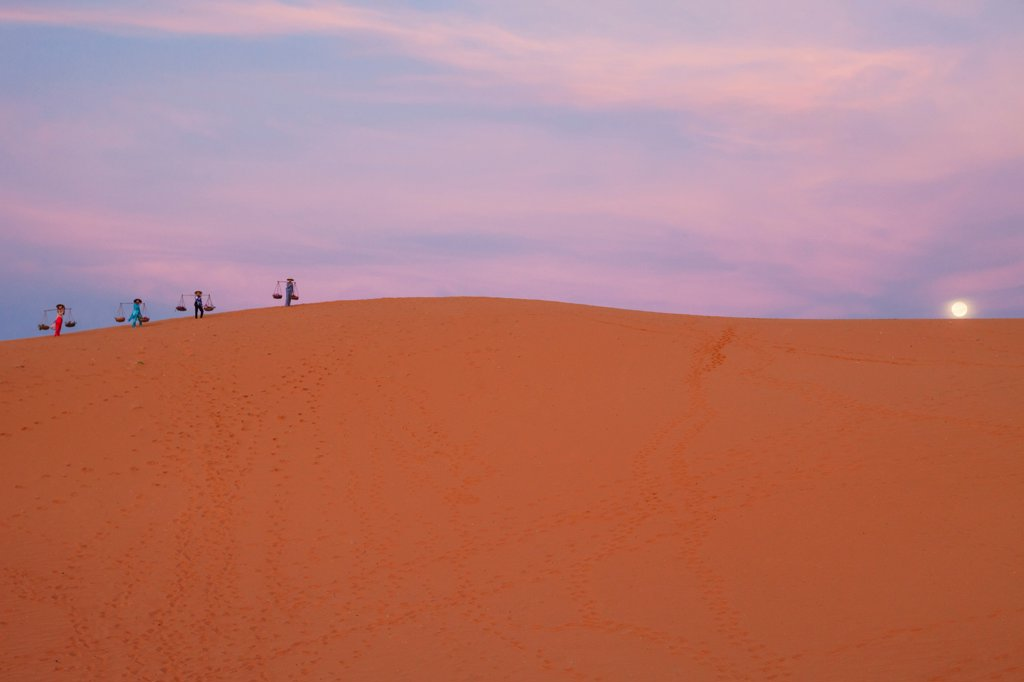 Stock Photo: 442-39105 Vietnam, Mui Ne, Sand Dunes, Local Women in Conical Hats at Dawn