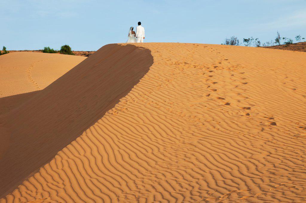Stock Photo: 442-39108 Vietnam, Mui Ne, Sand Dunes and Wedding Couple