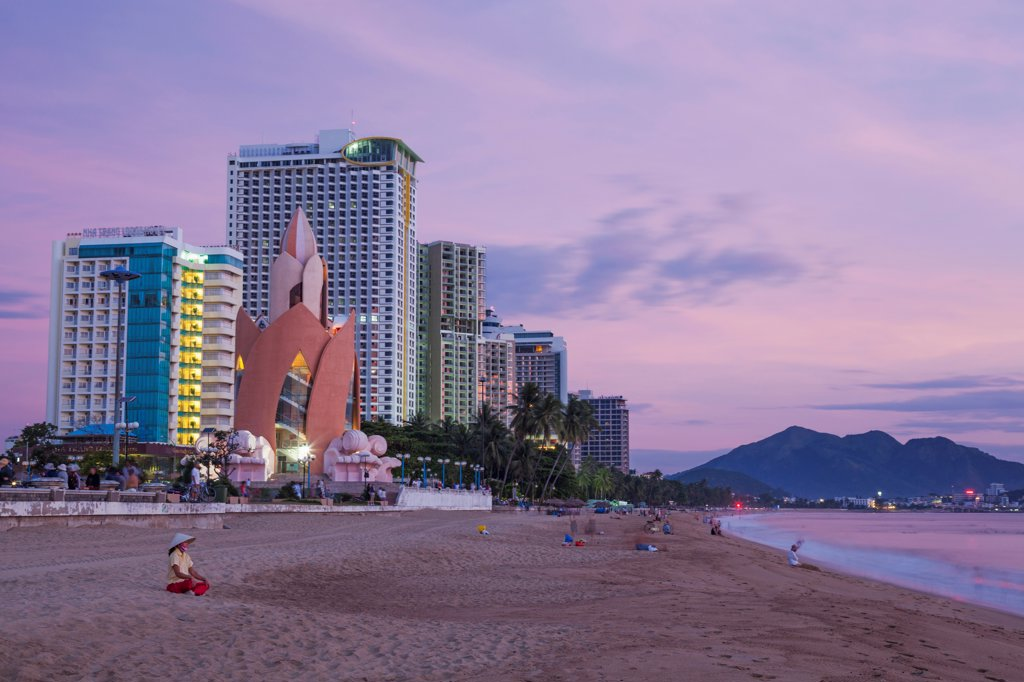 Vietnam, Nha Trang, Beachfront skyline at dusk : Stock Photo