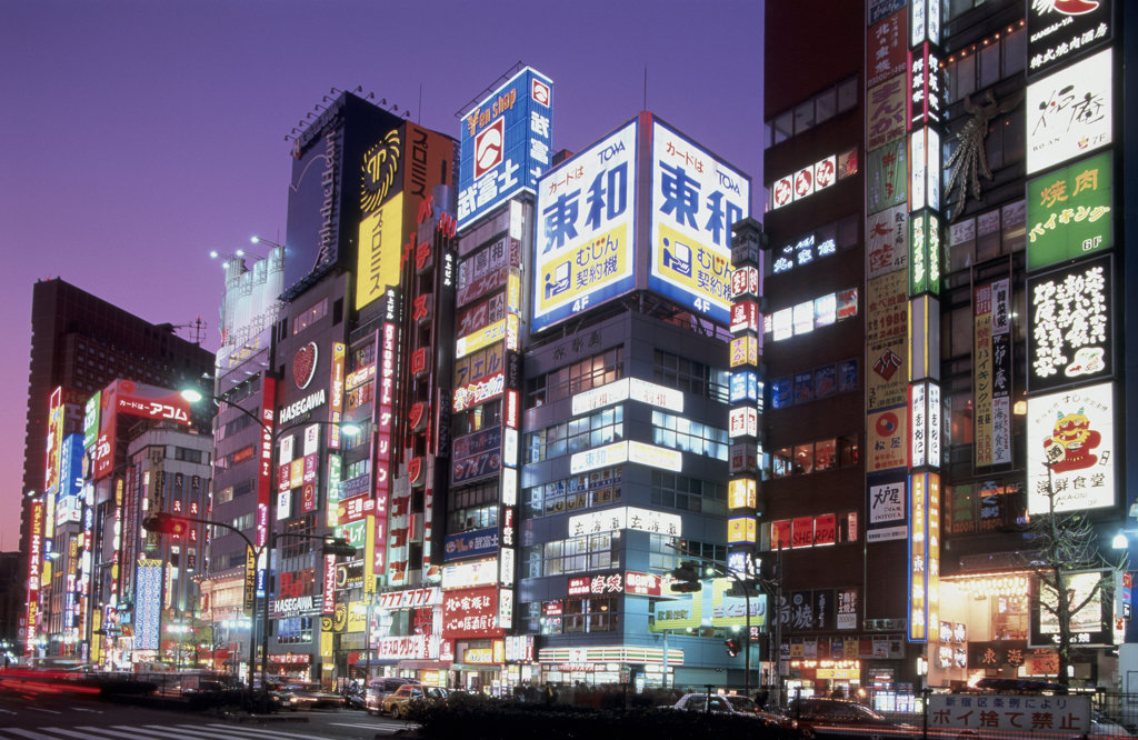 Shopping mall and stores lit up at night, Shinjuku Ward, Tokyo, Japan : Stock Photo