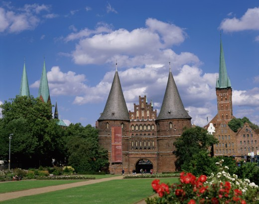 Stock Photo: 442-4484 Garden in front of a museum, Holstentor, Lubeck, Germany