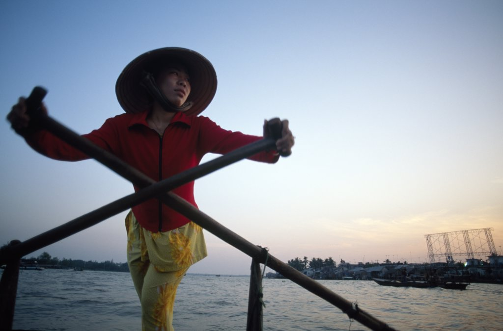 Young woman rowing a boat, Mekong River, Can Tho, Vietnam : Stock Photo
