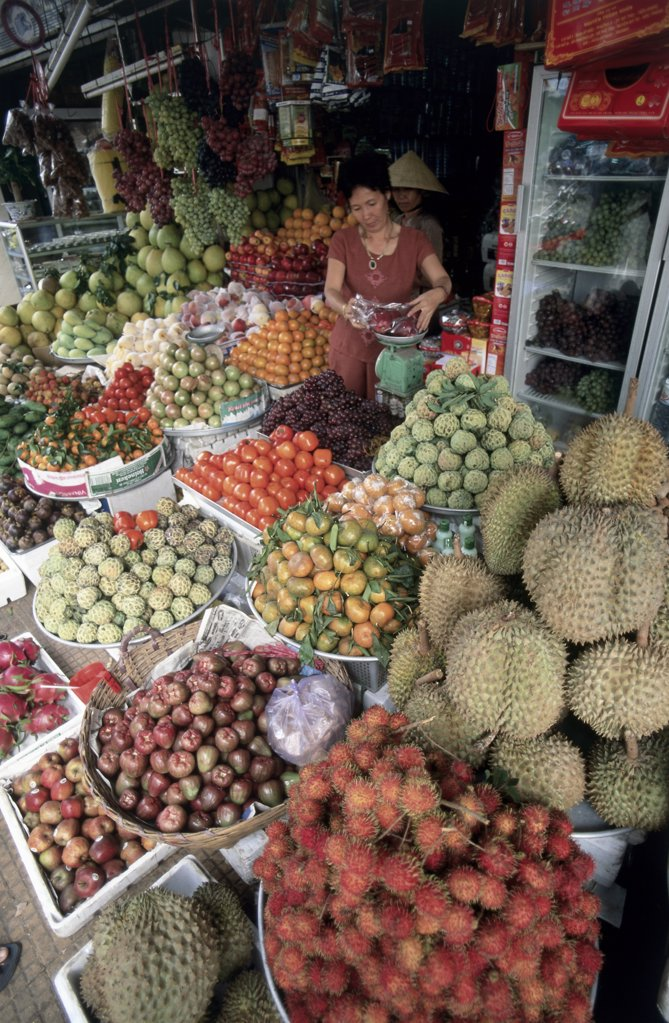 Mid adult woman selling fruits and vegetables, Can Tho, Vietnam : Stock Photo