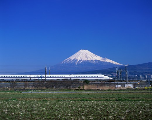 Stock Photo: 442-5424 Side profile of a bullet train with a mountain in the background, Mount Fuji, Japan