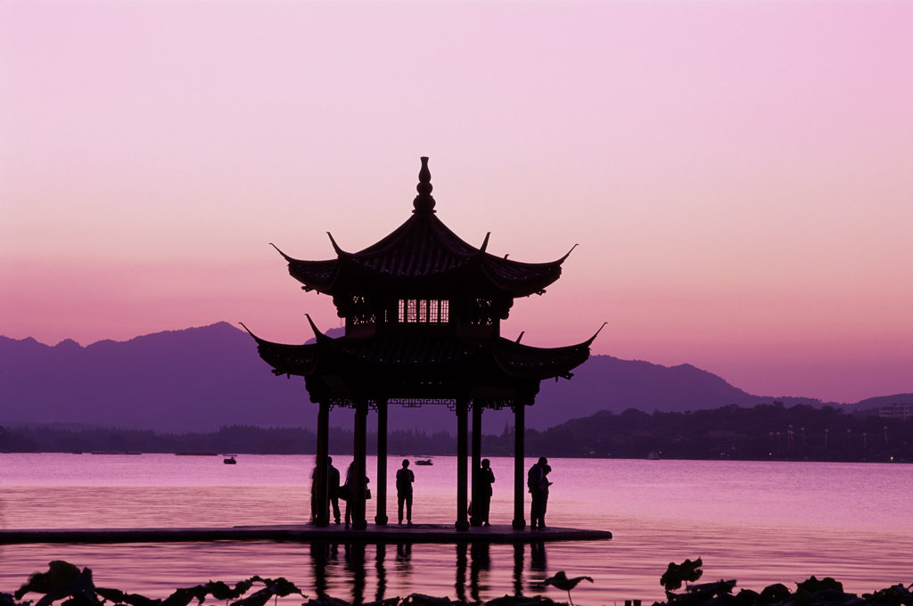Stock Photo: 442-5584 Silhouette of a pagoda in West Lake during sunset, Hangzhou, China