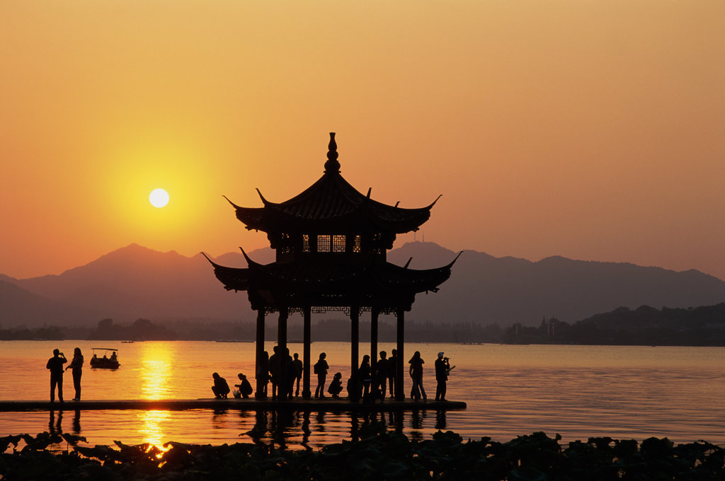 Silhouette of a pagoda in West Lake during sunset, Hangzhou, China : Stock Photo
