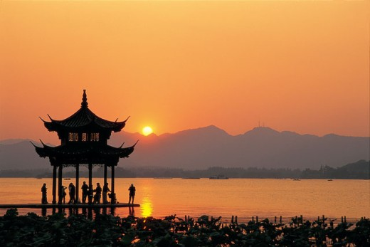 Stock Photo: 442-5606 Silhouette of a pagoda in West Lake during sunset, Hangzhou, China