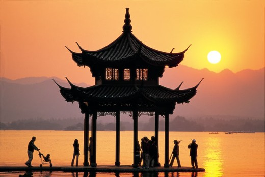 Stock Photo: 442-5607 Silhouette of a pagoda in West Lake during sunset, Hangzhou, China