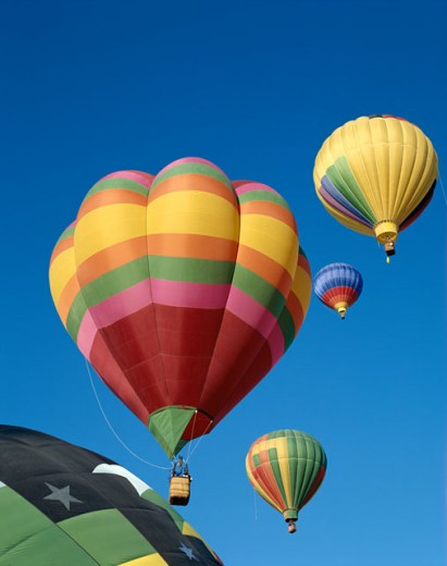 Stock Photo: 442-5762 Low angle view of hot air balloons in the sky, Albuquerque, New Mexico, USA