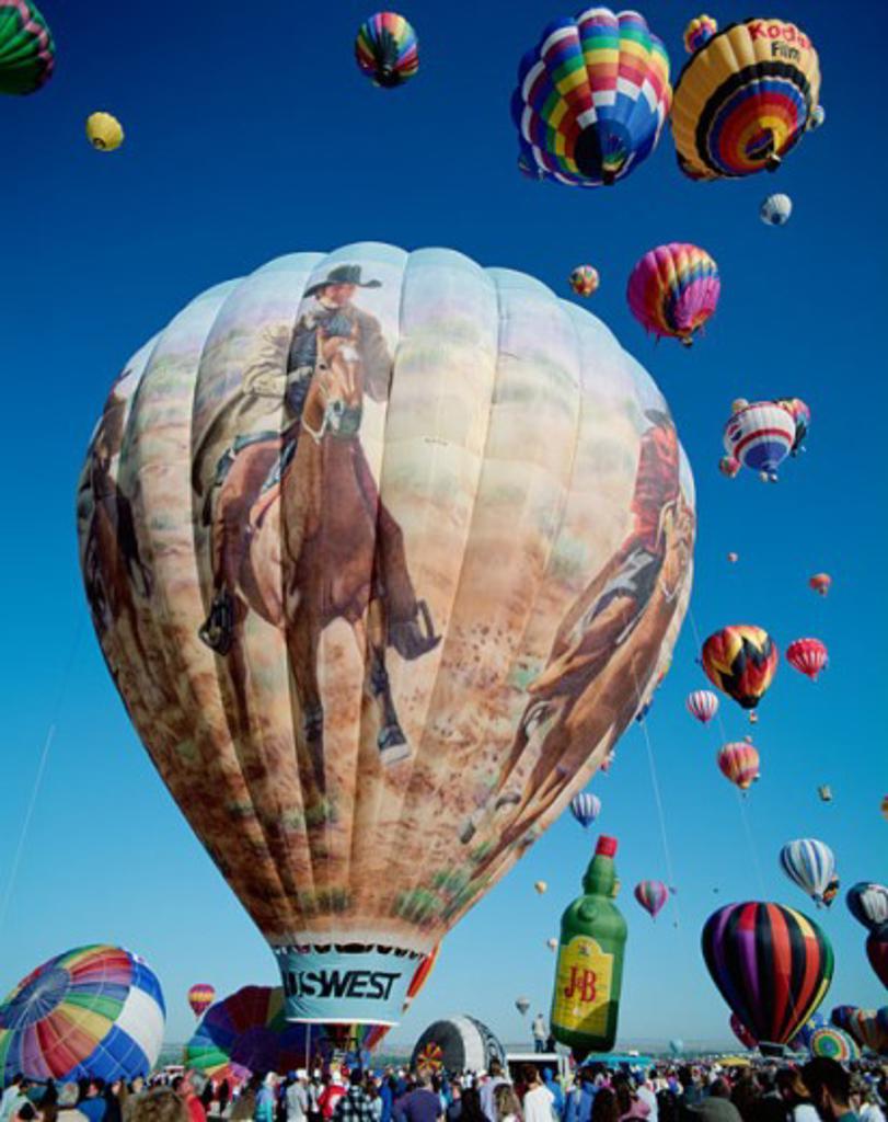 Stock Photo: 442-5779 Low angle view of hot air balloons in the sky, Albuquerque International Balloon Fiesta, Albuquerque, New Mexico, USA