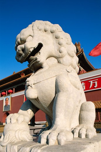 Low angle view of the statue of a lion in front of Tiananmen Gate, Tiananmen Square, Beijing, China : Stock Photo