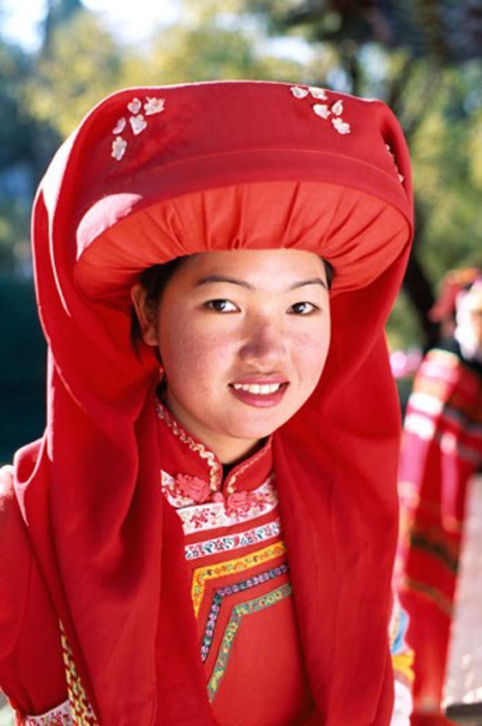 Stock Photo: 442-6090 Portrait of a teenage girl dressed in a Lisu Hilltribe costume, Lisu Minority, Lijiang, China