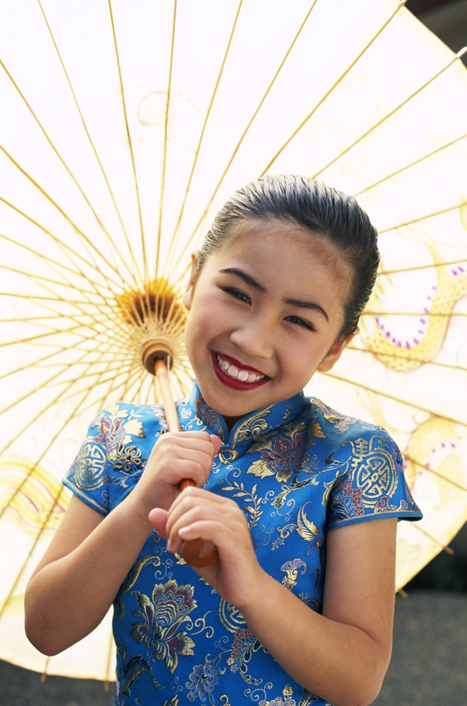 Stock Photo: 442-6165 Portrait of a girl dressed in a traditional Cheongsam Chinese dress, Beijing, China
