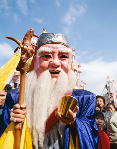 Stock Photo: 442-6185 Person wearing a Chinese Lucky God Mask, God of Longevity, Shanghai, China