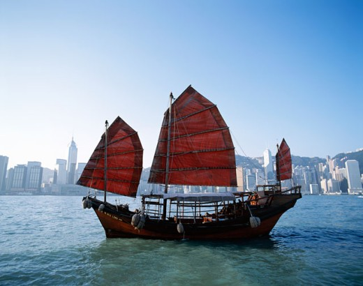 Junk sailing in Victoria Harbor, Hong Kong, China : Stock Photo