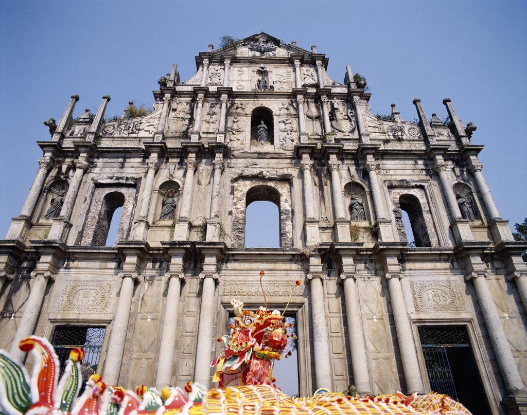 Traditional dragon dance on Chinese New Year in front of a church, Sao Paulo Church, Macao, China : Stock Photo