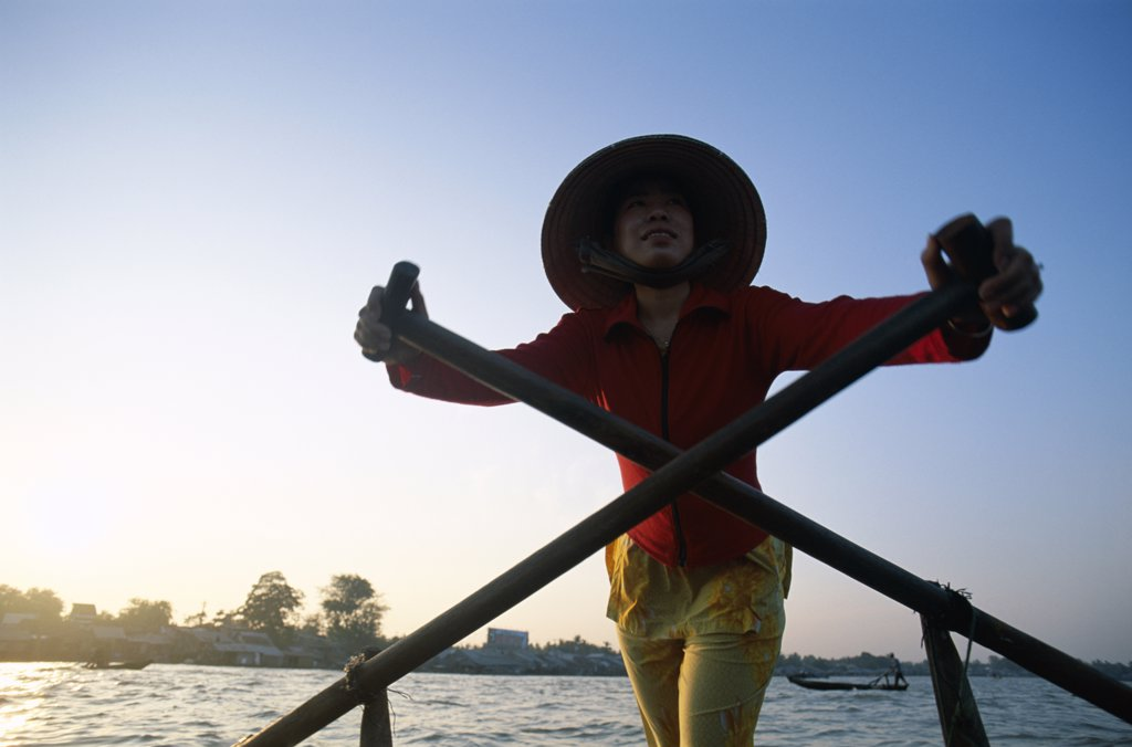 Young woman standing on a boat, Mekong River, Can Tho, Vietnam : Stock Photo