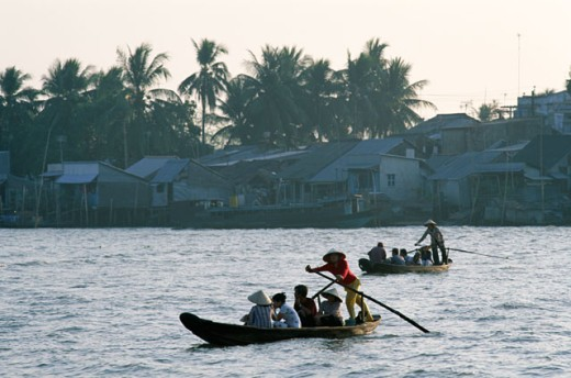 People sitting in canoes, Mekong River, Can Tho, Vietnam : Stock Photo