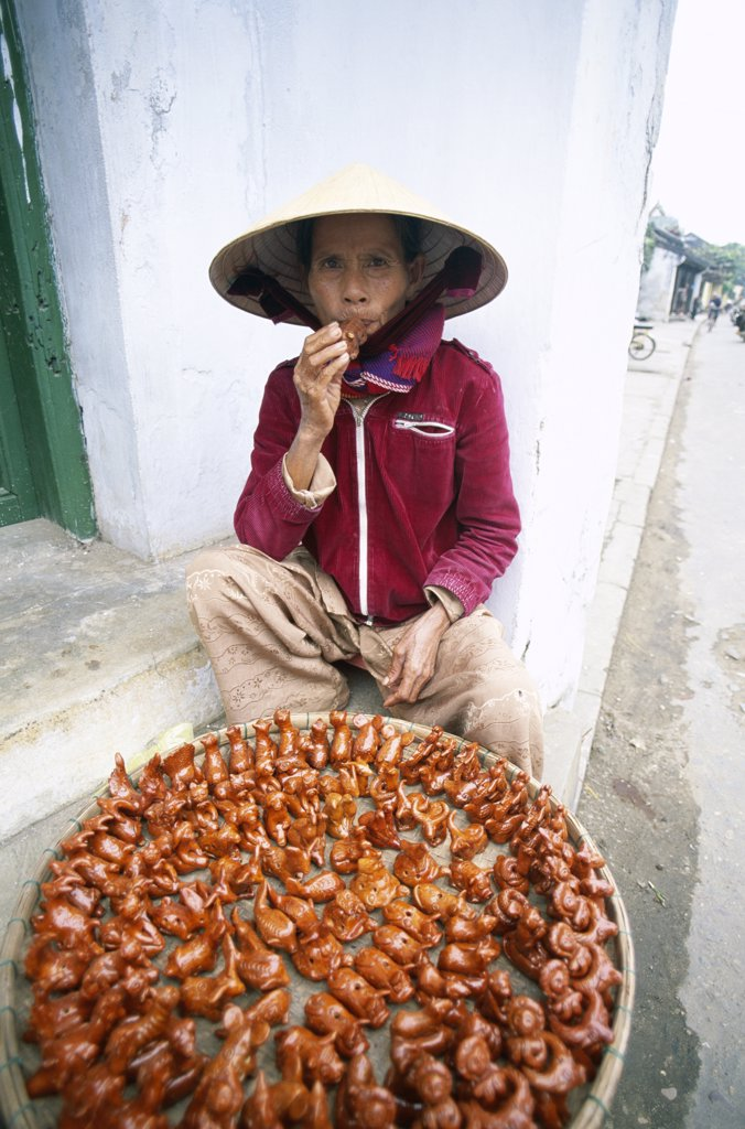 High angle view of a street vendor selling bird whistles, Hoi An, Vietnam : Stock Photo