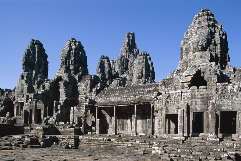 Facade of a Bayon temple, Angkor Thom, Siem Reap, Cambodia : Stock Photo