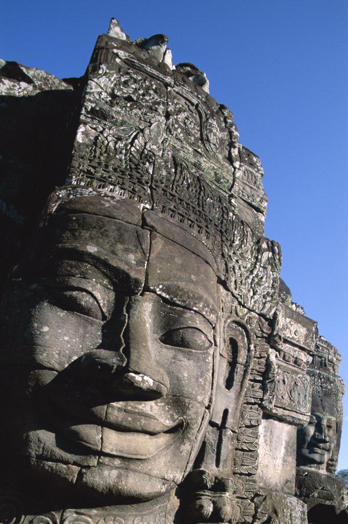 Stock Photo: 442-6358 Carved face of Lokesvara on a Bayon temple, Angkor Thom, Siem Reap, Cambodia