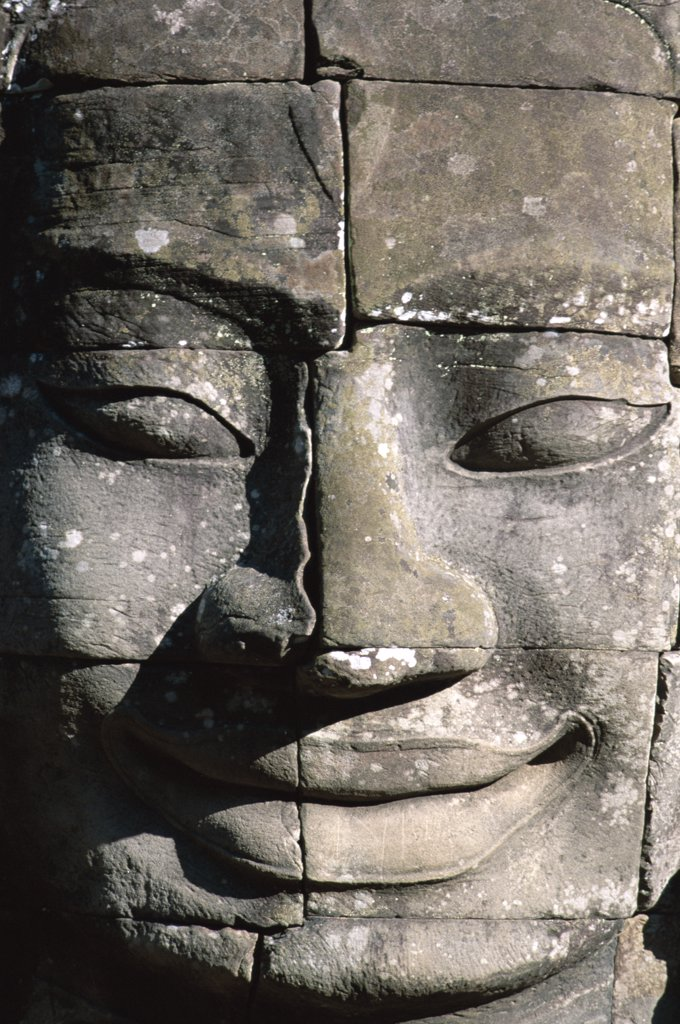 Stock Photo: 442-6359 Close-up of the carved face of Lokesvara on a Bayon Temple, Angkor Thom, Siem Reap, Cambodia