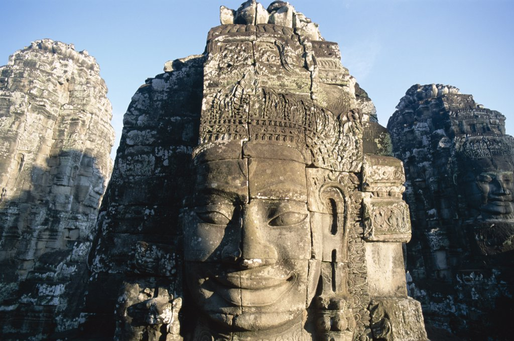 Stock Photo: 442-6361 Carved face of Lokesvara on a Bayon temple, Angkor Thom, Siem Reap, Cambodia
