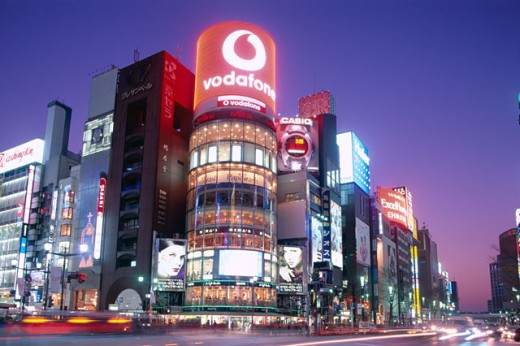 Low angle view of stores illuminated at night, Ginza, Tokyo, Honshu, Japan : Stock Photo
