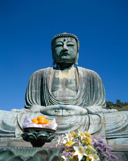 Stock Photo: 442-6668 Low angle view of a statue, Daibutsu (Great Buddha), Kamakura, Honshu, Japan