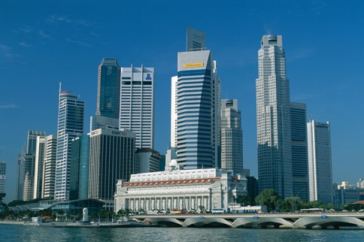 Skyscrapers in a city, Fullerton Building and Singapore River, Singapore : Stock Photo