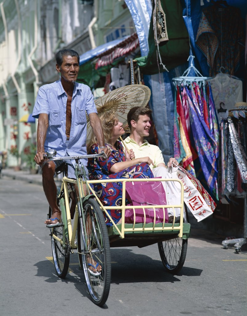 Tourists in a rickshaw, Chinatown, Singapore : Stock Photo