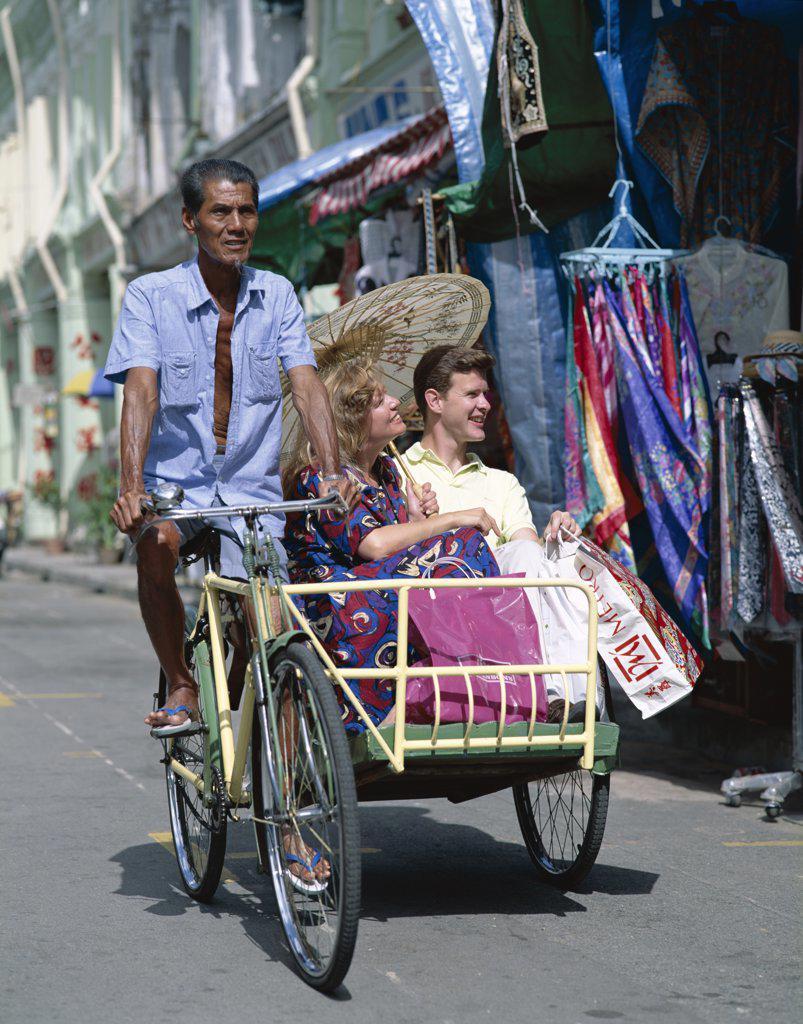 Stock Photo: 442-6838 Tourists in a rickshaw, Chinatown, Singapore