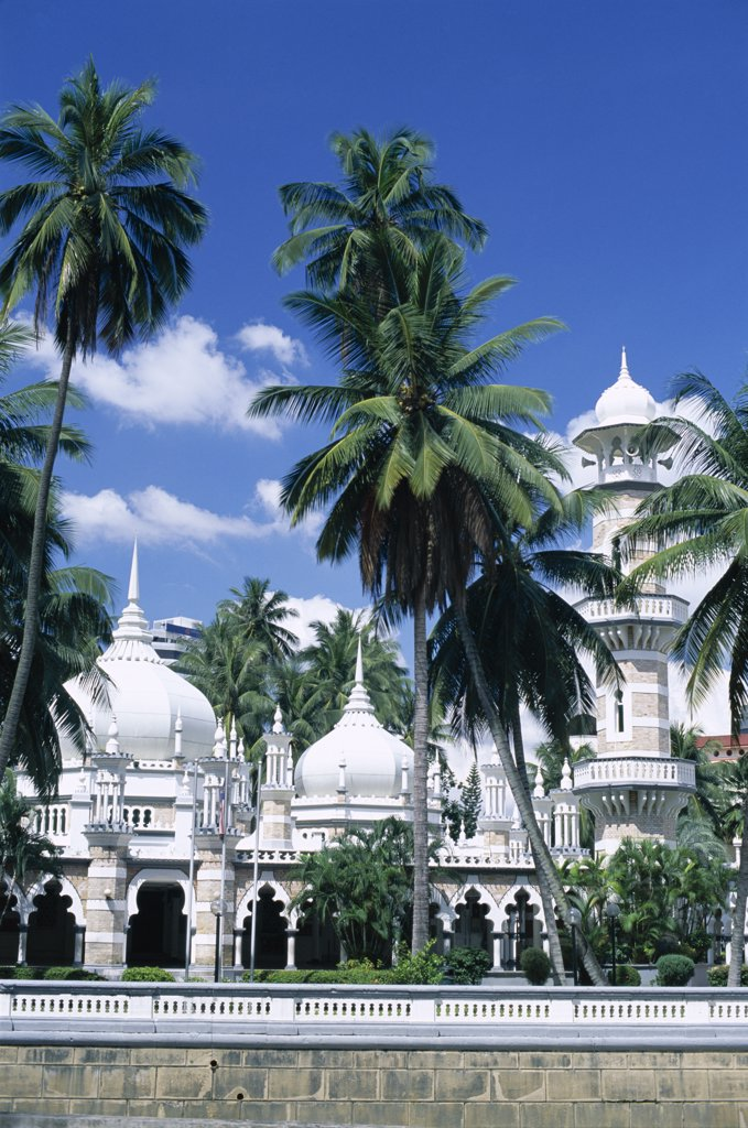 Palm trees in front of the a mosque, Masjid Jame Mosque, Kuala Lumpur, Malaysia : Stock Photo