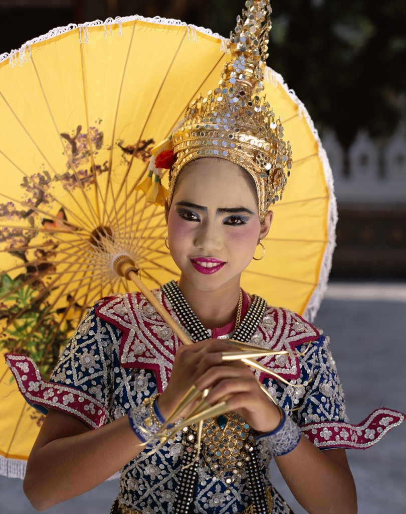 Stock Photo: 442-7263 Portrait of a teenage girl dressed in a traditional dancing costume, Bangkok, Thailand