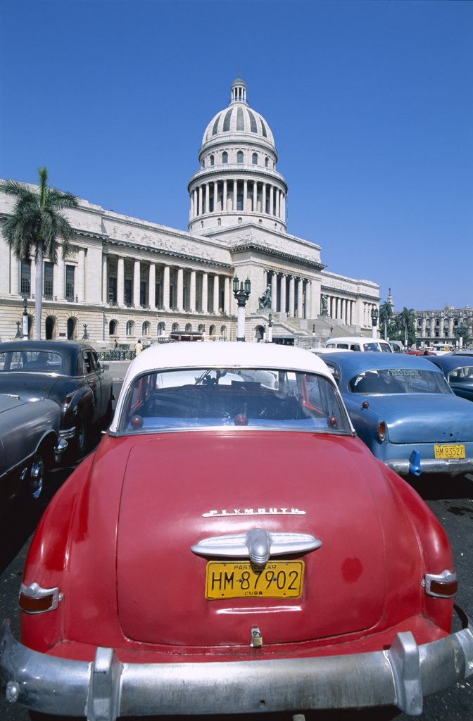 Close-up of vintage cars parked in front of a government building, Capitol Building, Havana, Cuba : Stock Photo