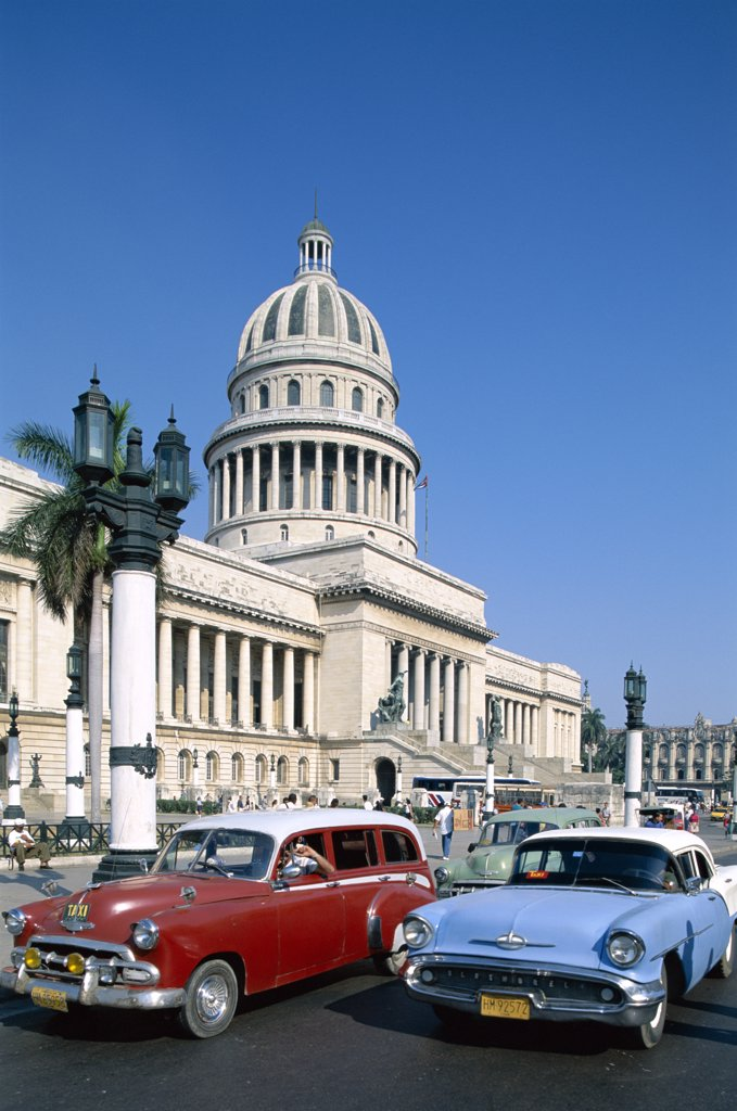 Stock Photo: 442-7829 Vintage cars parked in front of a government building, Capitol Building, Havana, Cuba